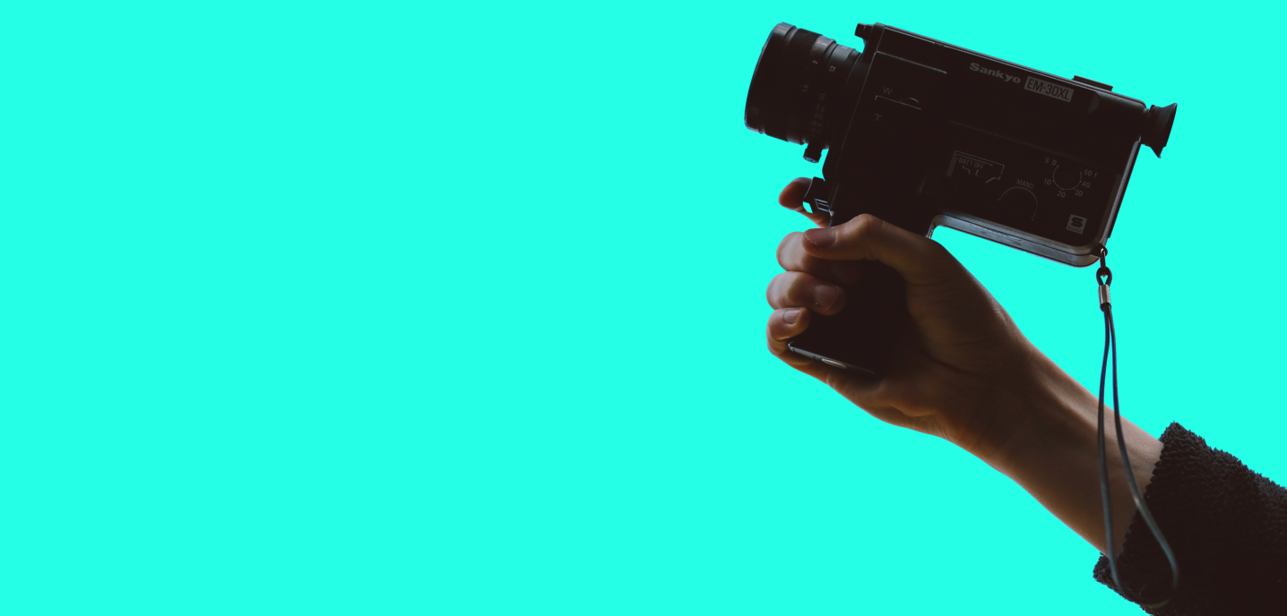 hand stretched out holding a video camera